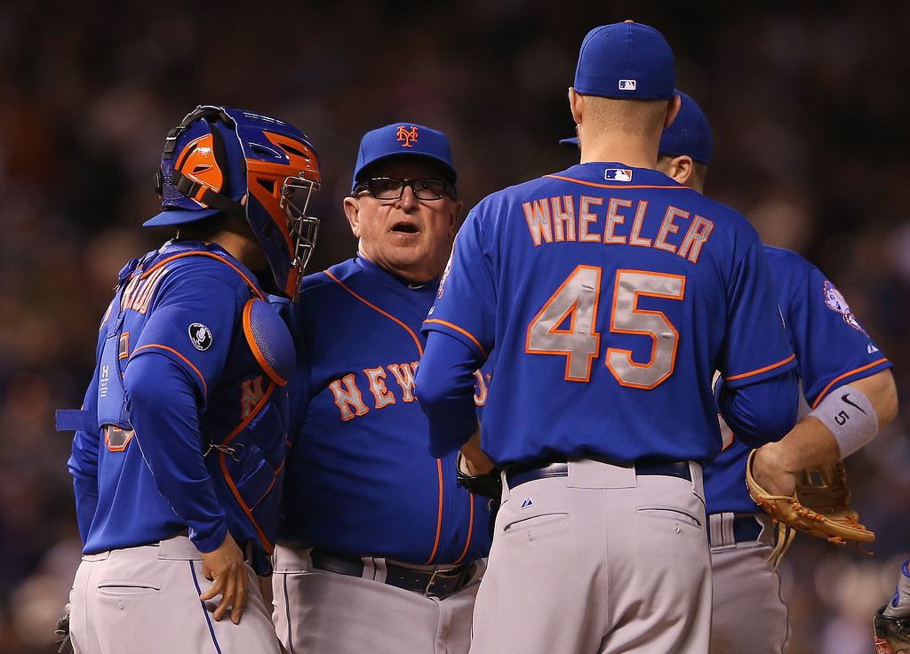 . DENVER, CO - MAY 02:  Pitching coach Dan Warthen #59 of the New York Mets visits the mound to talk to starting pitcher Zack Wheeler #45 of the New York Mets and catcher Travis d\'Arnaud #15 of the New York Mets as they face the Colorado Rockies at Coors Field on May 2, 2014 in Denver, Colorado.  (Photo by Doug Pensinger/Getty Images)
