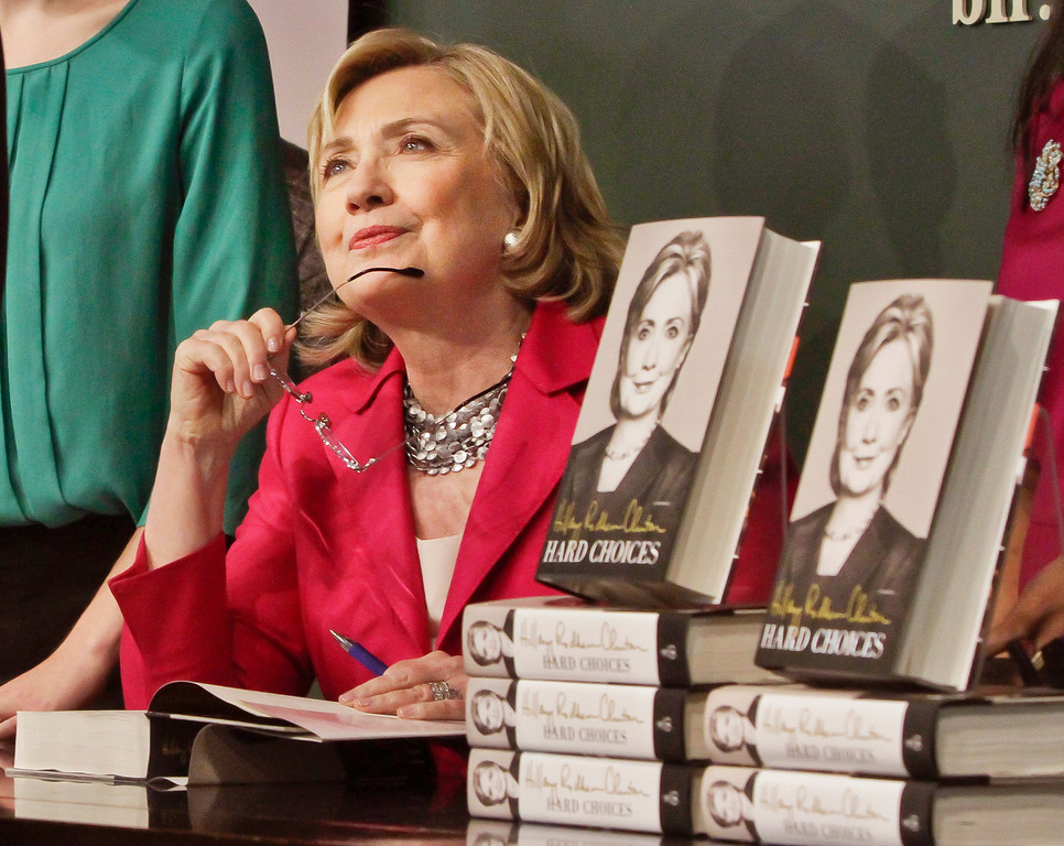 . HiIlary Rodham Clinton listens before signing a copy of her book on Tuesday June 10, 2014, at Barnes and Noble bookstore in New York.  (AP Photo/Bebeto Matthews)