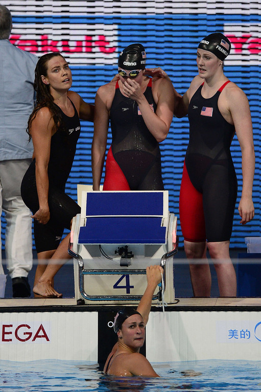 . (Top R-L) US swimmer Missy Franklin, US swimmer Shannon Vreeland, US swimmer Natalie Coughlin and US swimmer Megan Romano (bottom) react after winning the final of the women\'s 4x100-metre freestyle relay swimming event in the FINA World Championships at Palau Sant Jordi in Barcelona on July 28, 2013.  LLUIS GENE/AFP/Getty Images