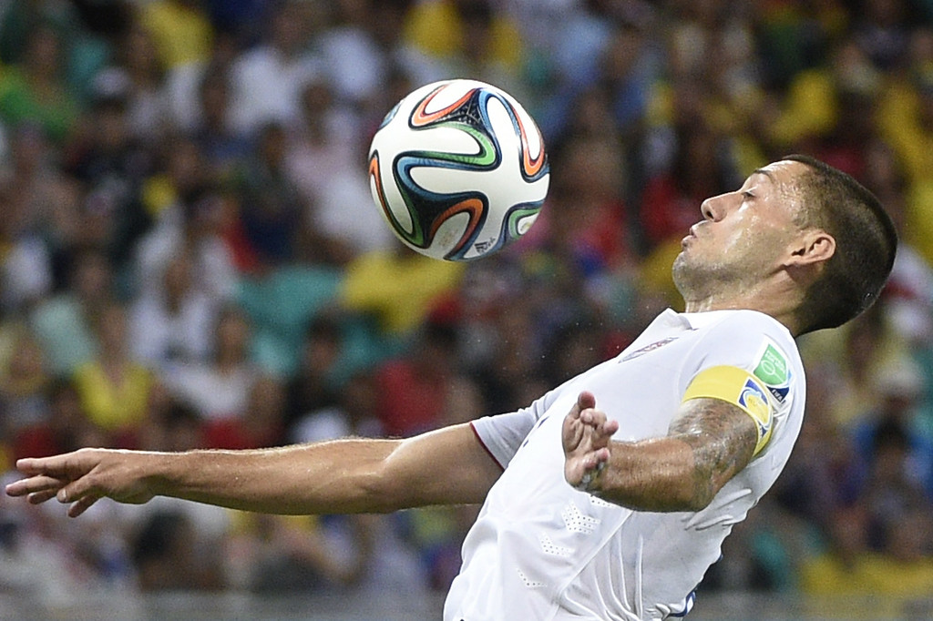 . US forward and captain Clint Dempsey controls the ball during a Round of 16 football match between Belgium and USA at Fonte Nova Arena in Salvador during the 2014 FIFA World Cup on July 1, 2014. AFP PHOTO / MARTIN  BUREAU/AFP/Getty Images