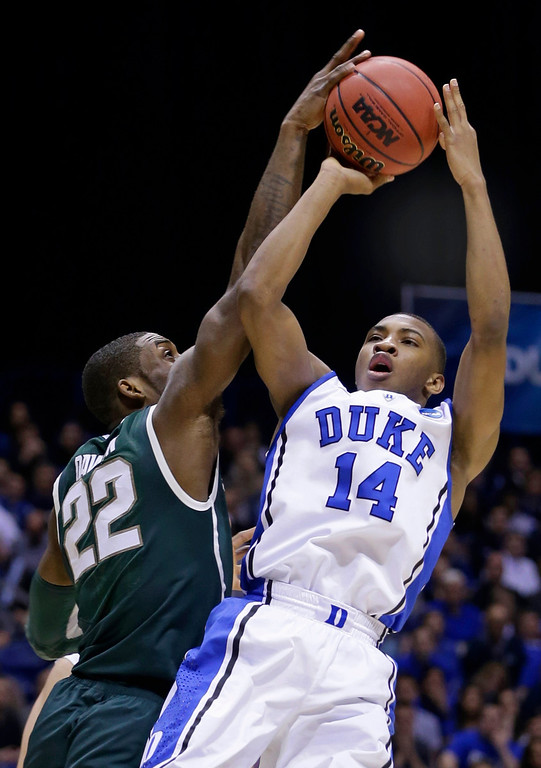 . Michigan State forward Branden Dawson (22) blocks a shot by Duke guard Rasheed Sulaimon (14) during the first half of a regional semifinal in the NCAA college basketball tournament, Friday, March 29, 2013, in Indianapolis. (AP Photo/Darron Cummings)