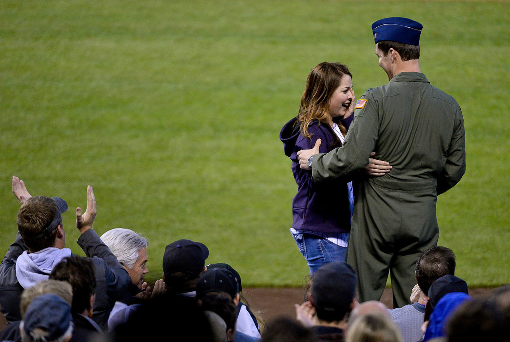 . DENVER, CO. - MAY 20: United States Air Force Capt. Daniel Kulp surprises his sister on top of the dugout at the Colorado Rockies Arizona Diamondbacks game May 20, 2013 at Coors Field. Daniel stationed in Japan came home to see his sister graduate from Center High School in Center, Colorado. (Photo By John Leyba/The Denver Post)