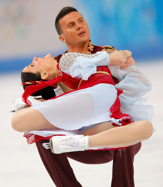 . Charlene Guignard and Marco Fabbri of Italy compete in the ice dance free dance figure skating finals at the Iceberg Skating Palace during the 2014 Winter Olympics, Monday, Feb. 17, 2014, in Sochi, Russia. (AP Photo/Vadim Ghirda)