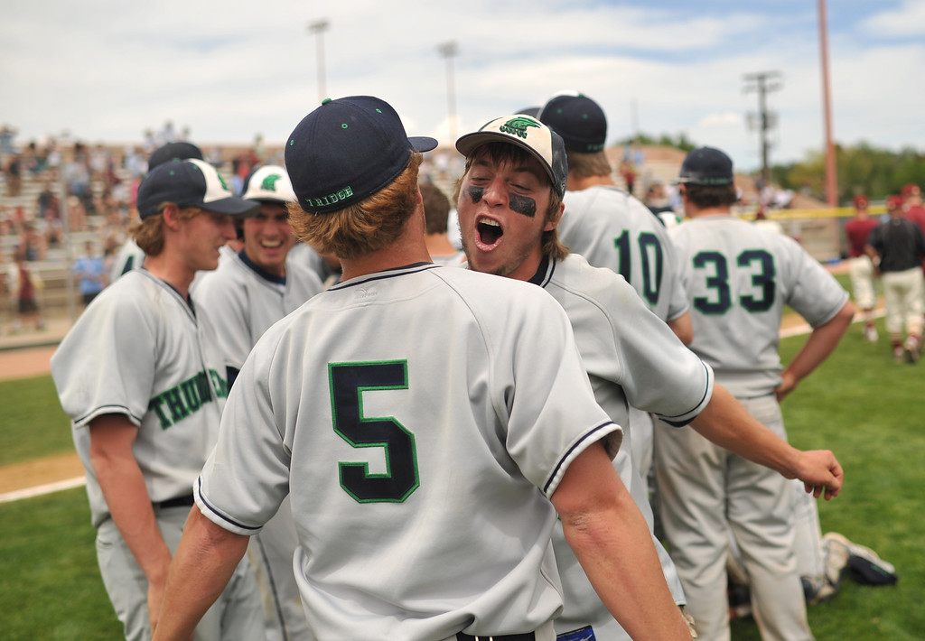 . DENVER, CO. - MAY 25: Rowdy Sheets (5) and Josh Newell (3) of ThunderRidge HIgh School celebrate winning of 5A baseball state championship game against Rocky Mountain HIgh School at All City Field. Denver, Colorado. May 25, 2013. ThunderRidge won 2-1. (Photo By Hyoung Chang/The Denver Post)