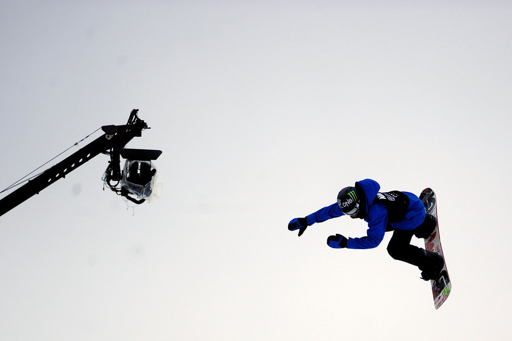 . ASPEN, CO. - JANUARY 24: Aleksander Oestreng hits a jump during the men\'s Snowboard Slopestyle elimination. Men\'s Snowboard Slopestyle elimination X Games Aspen Buttermilk Mountain Aspen January 24, 2013. (Photo By AAron Ontiveroz / The Denver Post)