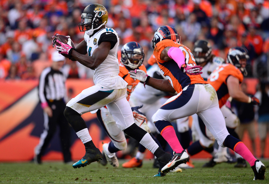 . Jacksonville Jaguars wide receiver Justin Blackmon (14) makes a run in the third quarter. The Denver Broncos took on the Jacksonville Jaguars at Sports Authority Field at Mile High in Denver on October 13, 2013. (Photo by AAron Ontiveroz/The Denver Post)