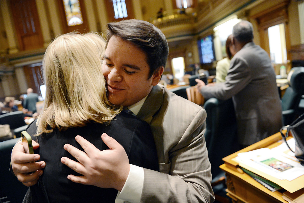 . Colorado Representative Dominick Moreno, D-Commerce City, gets a hug from Rep Brittany Petteren, D-Lakewood, following the vote on Senate Bill 11 in the Colorado House of Representatives in Denver, CO March 12, 2013. (Photo By Craig F. Walker/The Denver Post)