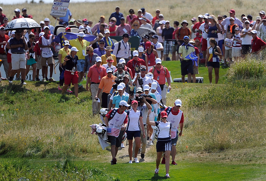 . PARKER, CO - Aug.17: Team USA\'s Paula Creamer  leads the way and encourages the crowd to cheer as she walks up the 17th fairway. The 2013 Solheim Cup takes place at the Colorado Golf Club with the USA taking on Europe in the Saturday morning Foursomes Match. (Photo By Kathryn Scott Osler/The Denver Post)