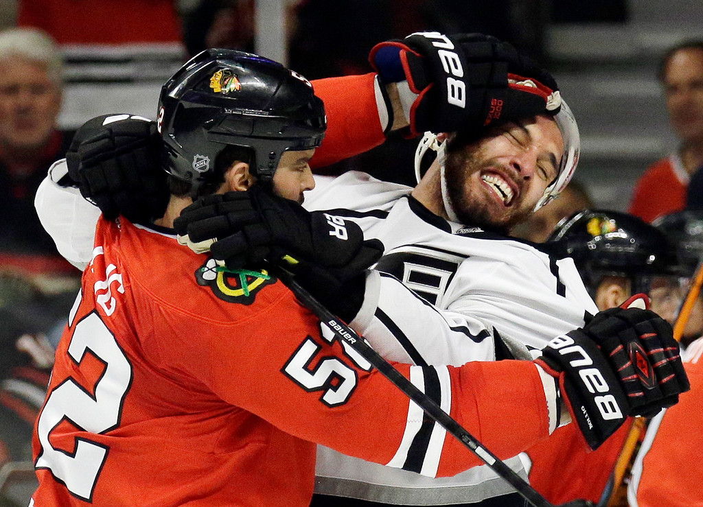 . Chicago Blackhawks left wing Brandon Bollig (52) and Los Angeles Kings left wing Dwight King (74) fight during the first period in Game 7 of the Western Conference finals in the NHL hockey Stanley Cup playoffs Sunday, June 1, 2014, in Chicago. (AP Photo/Nam Y. Huh)