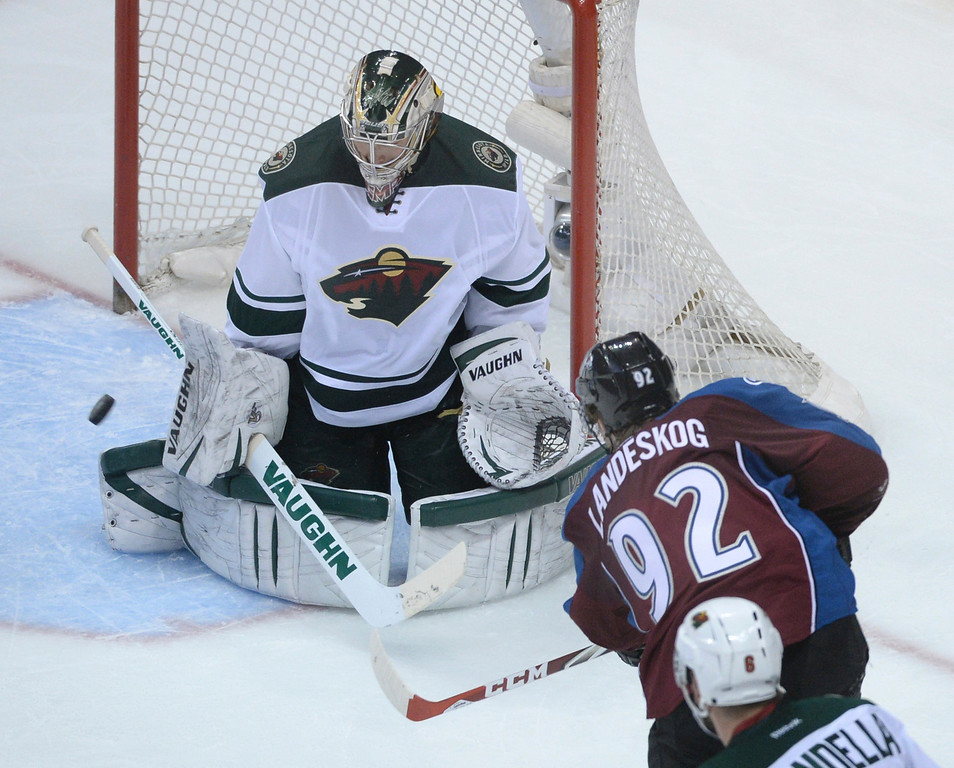 . DENVER, CO - APRIL 24: Minnesota goalie Darcy Kuemper made a save on a Gabriel Landeskog attempt in the second period. The Colorado Avalanche hosted the Minnesota Wild in the fifth game of a playoff series Saturday night, April 26, 2014. (Photo by Karl Gehring/The Denver Post)
