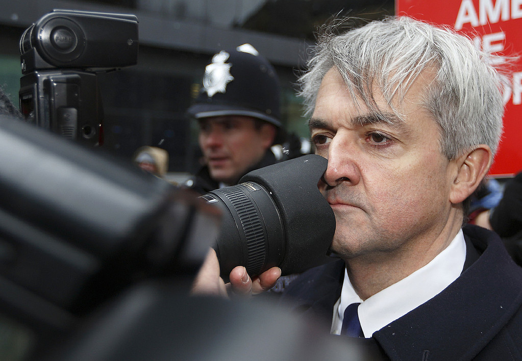 . Former British energy minister Chris Huhne (R) comes into contact with a photographers lens as he arrives at Southwark Crown Court in London, on March 11, 2013. Huhne and his ex-wife Vicky Pryce were due to be sentenced later Monday for perverting the course of justice over speeding points a decade ago.   JUSTIN TALLIS/AFP/Getty Images