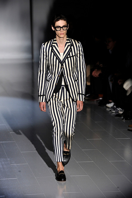 . A model wears a creation for Gucci men\'s Spring-Summer 2015 collection, part of the Milan Fashion Week, unveiled in Milan, Italy, Monday, June 23, 2014. (AP Photo/Giuseppe Aresu)