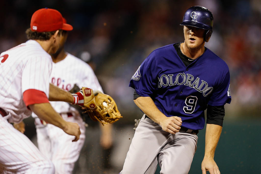 . DJ LeMahieu #9 of the Colorado Rockies is caught attempting to steal second base in the ninth inning of the game against the Philadelphia Phillies at Citizens Bank Park on August 19, 2013 in Philadelphia, Pennsylvania. The Phillies won 5-4. (Photo by Brian Garfinkel/Getty Images)