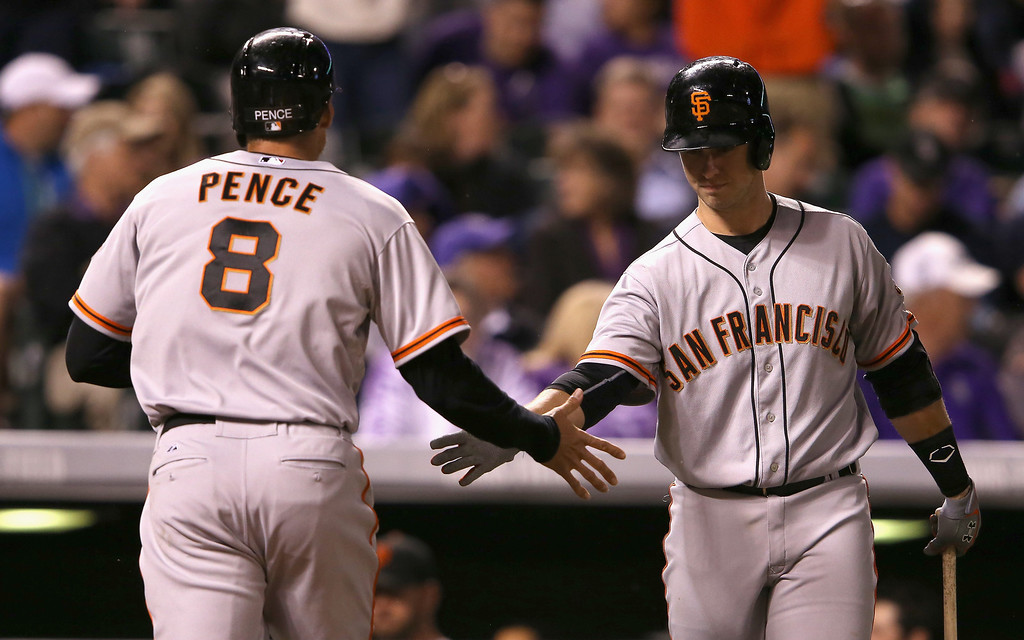 . Hunter Pence #8 of the San Francisco Giants is congratulated for his solo home run off of starting pitcher Franklin Morales #56 of the Colorado Rockies by Buster Posey #28 of the San Francisco Giants to tie the score 1-1 in the fifth inning at Coors Field on April 22, 2014 in Denver, Colorado.  (Photo by Doug Pensinger/Getty Images)