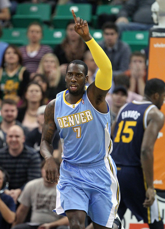 . Denver Nuggets J.J. Hickson (7) celebrates after scoring against the Utah Jazz in the fourth quarter during an NBA basketball game Monday, Nov. 11, 2013, in Salt Lake City.  Denver Nuggets won 100-81. (AP Photo/Rick Bowmer)