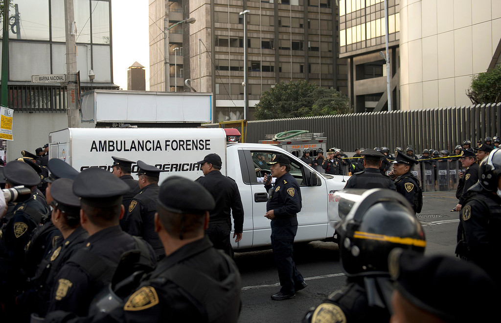 . A forensic ambulance arrives on the premises of the skyscraper that houses the headquarters of state-owned Mexican oil giant Pemex in Mexico City on January 31, 2013, following a blast inside the building.   YURI CORTEZ/AFP/Getty Images