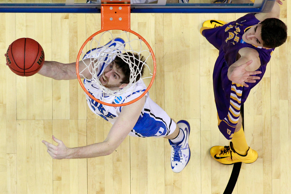 . Duke\'s Ryan Kelly, left, goes up for a shot as Albany\'s John Puk defends during the first half of a second-round game of the NCAA college basketball tournament, Friday, March 22, 2013, in Philadelphia. (AP Photo/Matt Slocum)