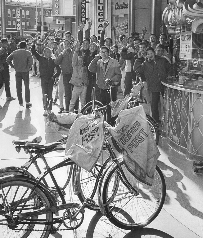 """. Denver Post carriers line up outside Denver\'s Centre Theatre Saturday morning for a special party honoring them on National Newspaperboy Day. The boys saw the new Warner Brothers comedy, \""""Kisses for My President.\"""" Refreshments were also served at the theater party.  (Photo by Ed Maker /The Denver Post Archive)"""