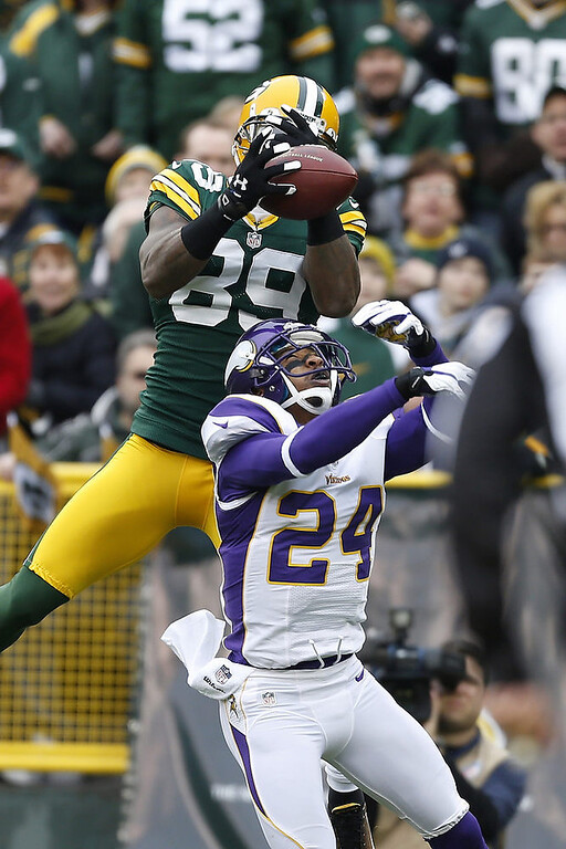 . James Jones #89 of the Green Bay Packers catches a touchdown pass over A.J. Jefferson #24 of the Minnesota Vikings at Lambeau Field on December 2, 2012 in Green Bay, Wisconsin.  (Photo by Wesley Hitt/Getty Images)