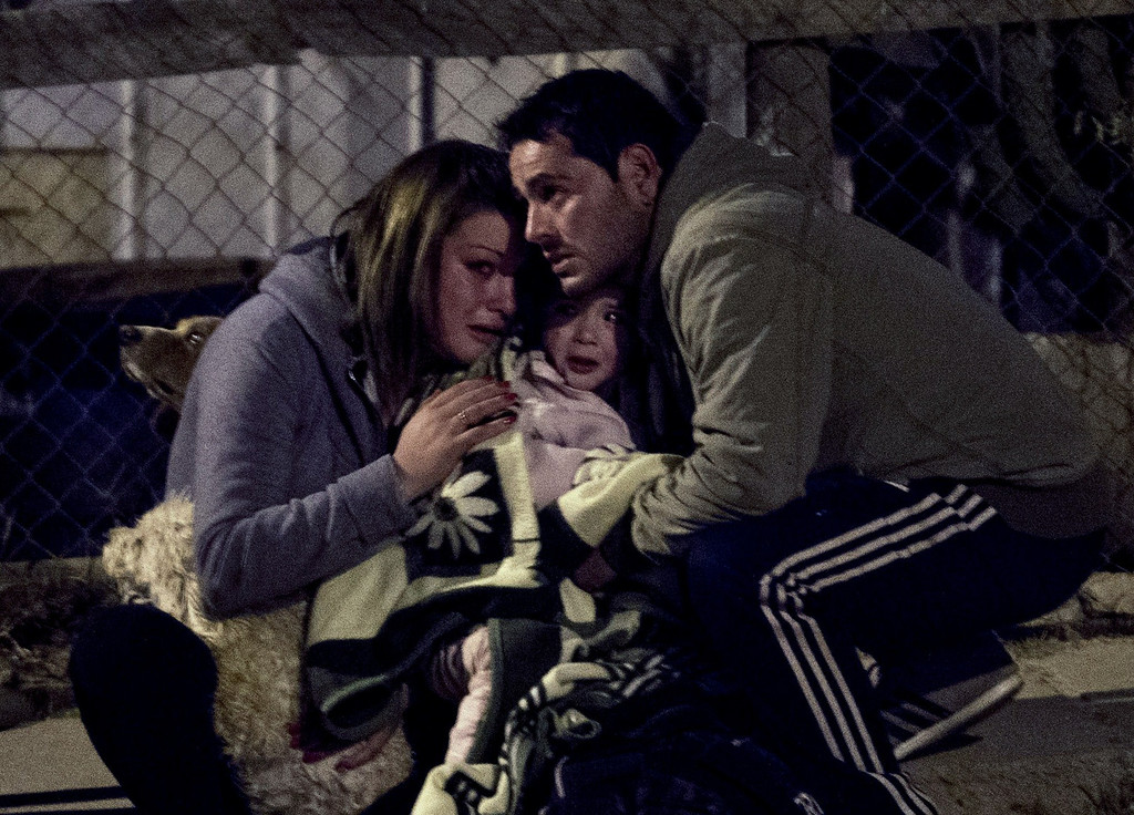 . A couple and their baby react after some fire focuses reactivated in Valparaiso, Chile, on April 13, 2014.  More than 10,000 people were evacuated as an army of firefighters battled a killer blaze that --on the eve-- tore through parts of Chile\'s historic port of Valparaiso and left at least 11 people dead. The fire, which started in woodland Saturday, gutted 500 homes as flames advanced on the city of 270,000, famed for its UNESCO-listed center with cobblestone streets and brightly painted wooden homes. AFP PHOTO/MARTIN BERNETTI