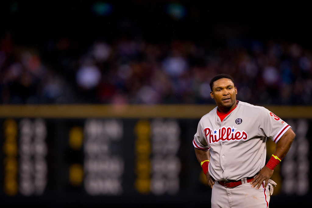 . Marlon Byrd #3 of the Philadelphia Phillies reacts after the Phillies failed to score during the fourth inning against the Colorado Rockies at Coors Field on April 19, 2014 in Denver, Colorado.  (Photo by Justin Edmonds/Getty Images)