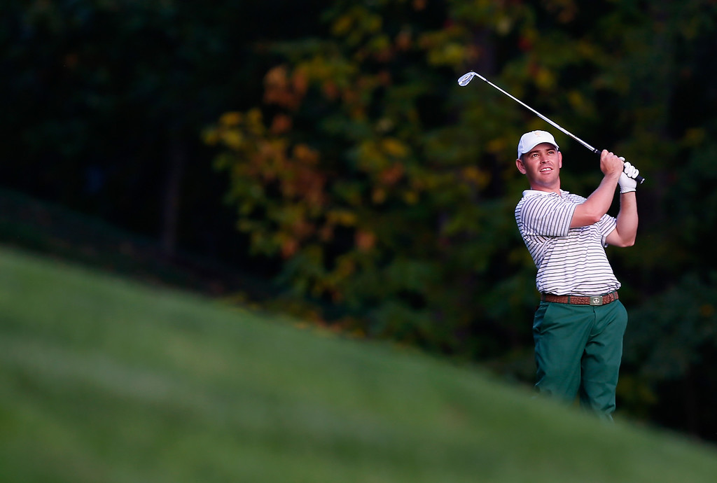. DUBLIN, OH - OCTOBER 03:  Louis Oosthuizen of South Africa and the International Team hits his third shot on the 15th hole during Day One Four-Ball Matches at the Muirfield Village Golf Club on October 3, 2013  in Dublin, Ohio.  (Photo by Matt Sullivan/Getty Images)