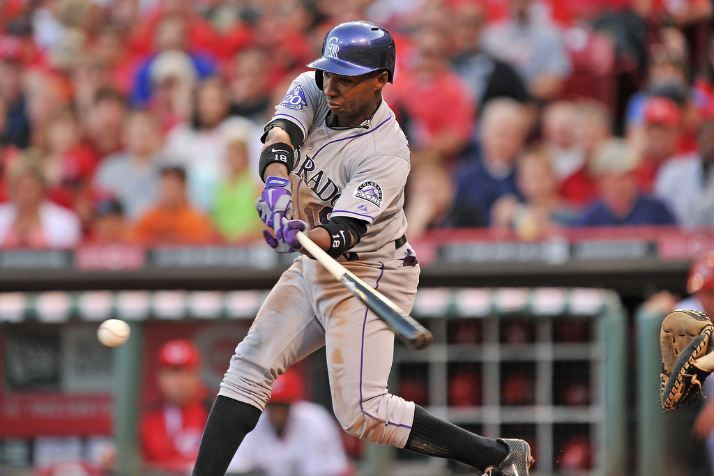 . Jonathan Herrera #18 of the Colorado Rockies grounds out in the fourth inning against the Cincinnati Reds at Great American Ball Park on June 4, 2013 in Cincinnati, Ohio. Colorado defeated Cincinnati 5-4.  (Photo by Jamie Sabau/Getty Images)