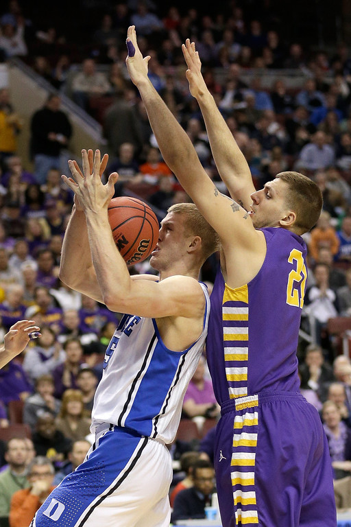 . Mason Plumlee #5 of the Duke Blue Devils with the ball against Blake Metcalf #21 of the Albany Great Danes in the first half during the second round of the 2013 NCAA Men\'s Basketball Tournament on March 22, 2013 at Wells Fargo Center in Philadelphia, Pennsylvania.  (Photo by Rob Carr/Getty Images)