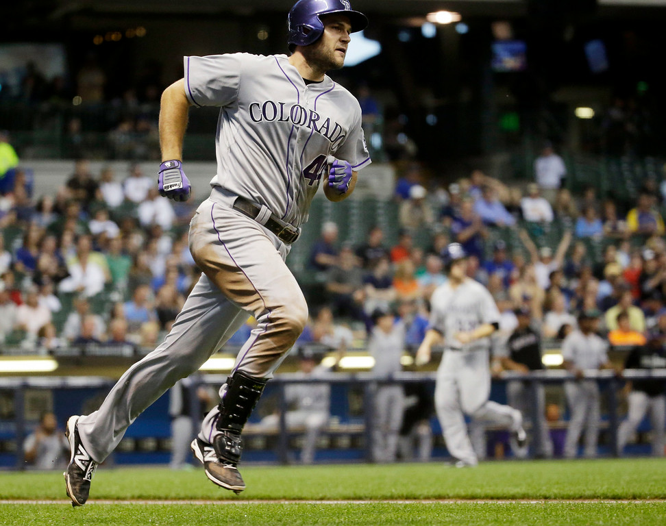 . Colorado Rockies\' Ryan Wheeler rounds the bases after hitting a grand slam during the fourth inning of a baseball game against the Milwaukee Brewers Thursday, June 26, 2014, in Milwaukee. (AP Photo/Morry Gash)