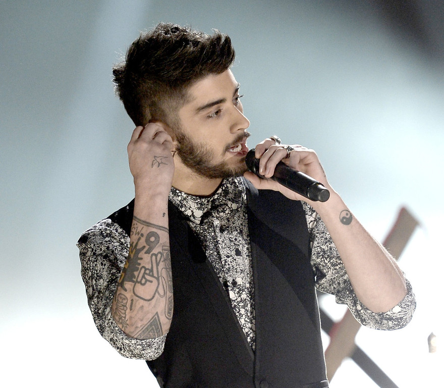 . Singer Zayn Malik of One Direction onstage during the 2013 American Music Awards at Nokia Theatre L.A. Live on November 24, 2013 in Los Angeles, California.  (Photo by Kevin Winter/Getty Images)