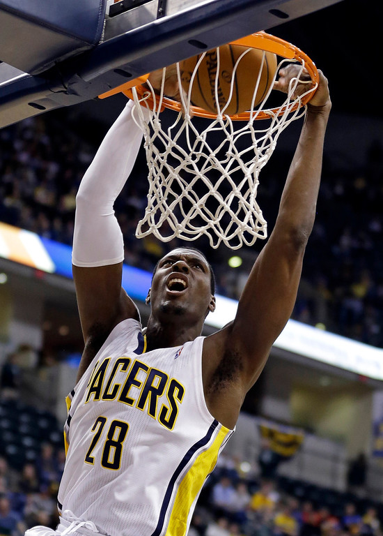 . Indiana Pacers center Ian Mahinmi dunks in the second half of an NBA basketball game against the Denver Nugget in Indianapolis, Monday, Feb. 10, 2014. The Pacers won 119-80. (AP Photo/Michael Conroy)