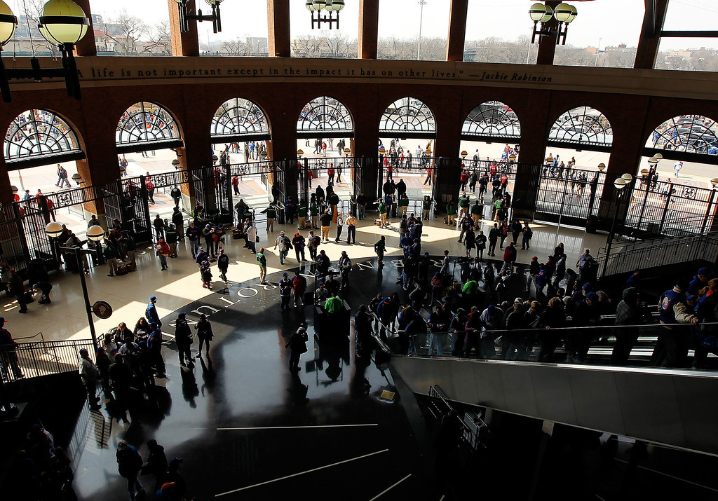 . Fans enter the Jackie Robinson rotunda prior to the opening day game between the New York Mets and the San Diego Padres at Citi Field on April 1, 2013 in New York City.  (Photo by Mike Stobe/Getty Images)
