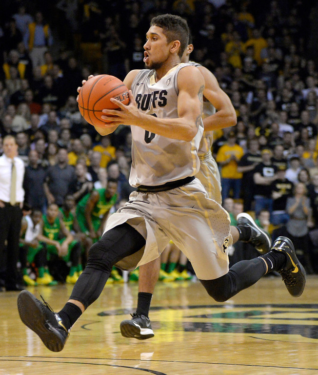 . Colorado Buffaloes guard Askia Booker (0) drives to the basket against the Oregon Ducks during the second half January 5, 2014 at Coors Events Center. The Colorado Buffaloes defeated the Oregon Ducks 100-91. (Photo by John Leyba/The Denver Post)