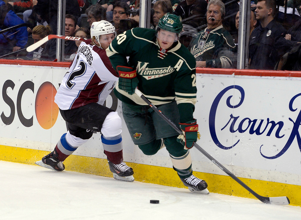 . Minnesota Wild defenseman Ryan Suter (20) skates the puck away from Colorado Avalanche left wing Gabriel Landeskog (92) during the first period April 24, 2014 at Xcel Energy Center. (Photo by John Leyba/The Denver Post)