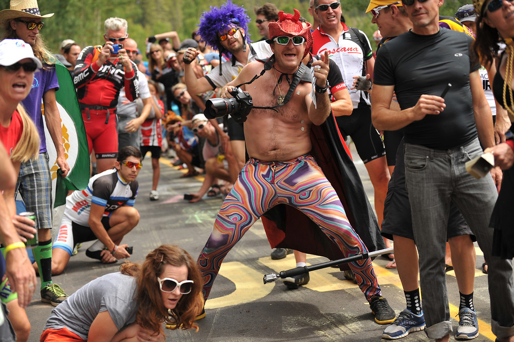 . People dance and party at Vail pass during the 10-mile Individual Time Trial of 2013 USA Pro Challenge, August 23, 2013. (Photo by Hyoung Chang/The Denver Post)