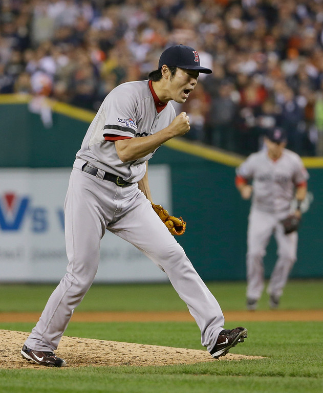 . Boston Red Sox\'s Koji Uehara celebrates after the Red Sox defeated the Detroit Tigers 1-0 in Game 3 of the American League baseball championship series Tuesday, Oct. 15, 2013, in Detroit. (AP Photo/Matt Slocum)