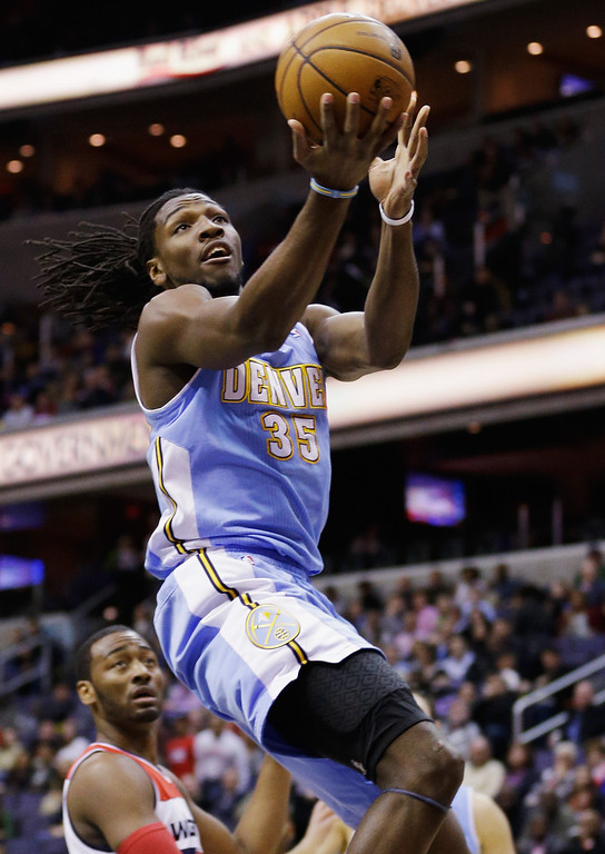 . WASHINGTON, DC - FEBRUARY 22: Kenneth Faried #35 of the Denver Nuggets puts up a shot in front of John Wall #2 of the Washington Wizards during the first half at Verizon Center on February 22, 2013 in Washington, DC.  (Photo by Rob Carr/Getty Images)
