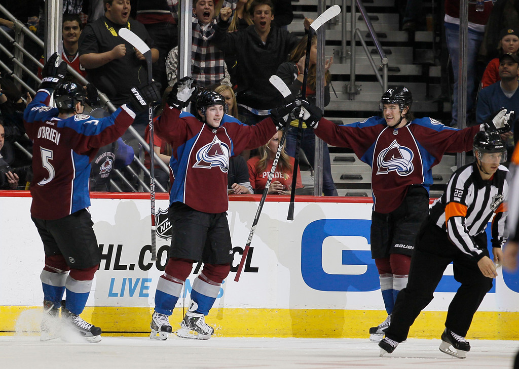 . Colorado Avalanche center Matt Duchene, center, celebrates after scoring a goal with defenseman Shane O\'Brien, left, and right wing PA Parenteau against the Chicago Blackhawks in the second period of an NHL hockey game in Denver, Friday, March 8, 2013. (AP Photo/David Zalubowski)