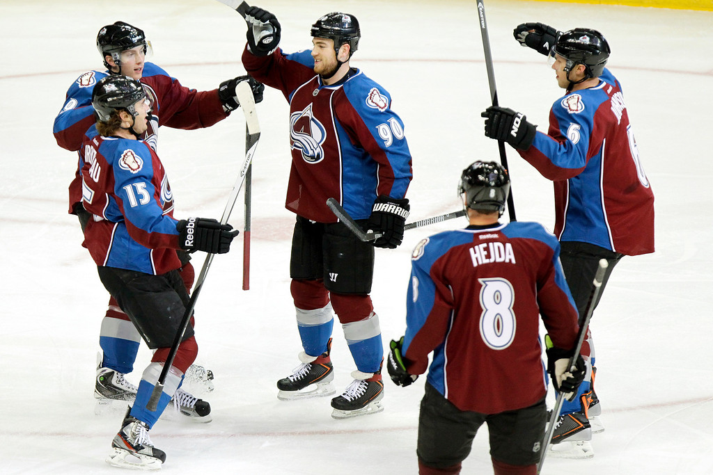 . Colorado Avalanches\' Ryan O\'Reilly (90) celebrates with teammates after scoring against the Calgary Flames during the first period of an NHL hockey game on Friday, Nov. 8, 2013, in Denver. (AP Photo/Barry Gutierrez)