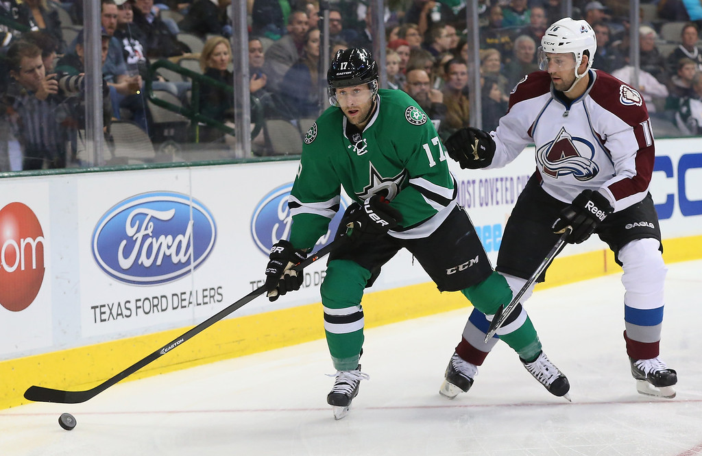 . Rich Peverley #17 of the Dallas Stars skates the puck against Cory Sarich #16 of the Colorado Avalanche in the first period at American Airlines Center on December 17, 2013 in Dallas, Texas.  (Photo by Ronald Martinez/Getty Images)
