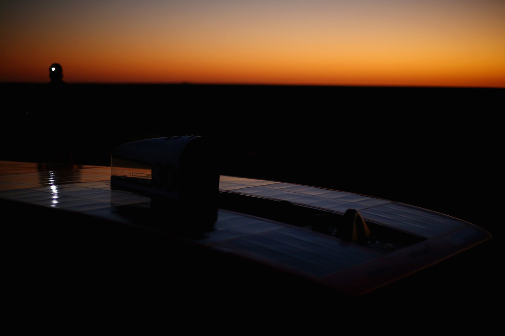 . ALICE SPRINGS, AUSTRALIA - OCTOBER 09:  A general view of Arrow1 from Team Arrow, Associated with Queensland University of Technology in Australia is seen in the pre-dawn light before racing on Day 4 on October 9, 2013 between Alice Springs and Kulgera, Australia. Over 25 teams from across the globe are competing in the 2013 World Solar Challenge - a 3000 km solar-powered vehicle race between Darwin and Adelaide. The race began on October 6th with the first car expected to cross the finish line on October 10th.  (Photo by Mark Kolbe/Getty Images)