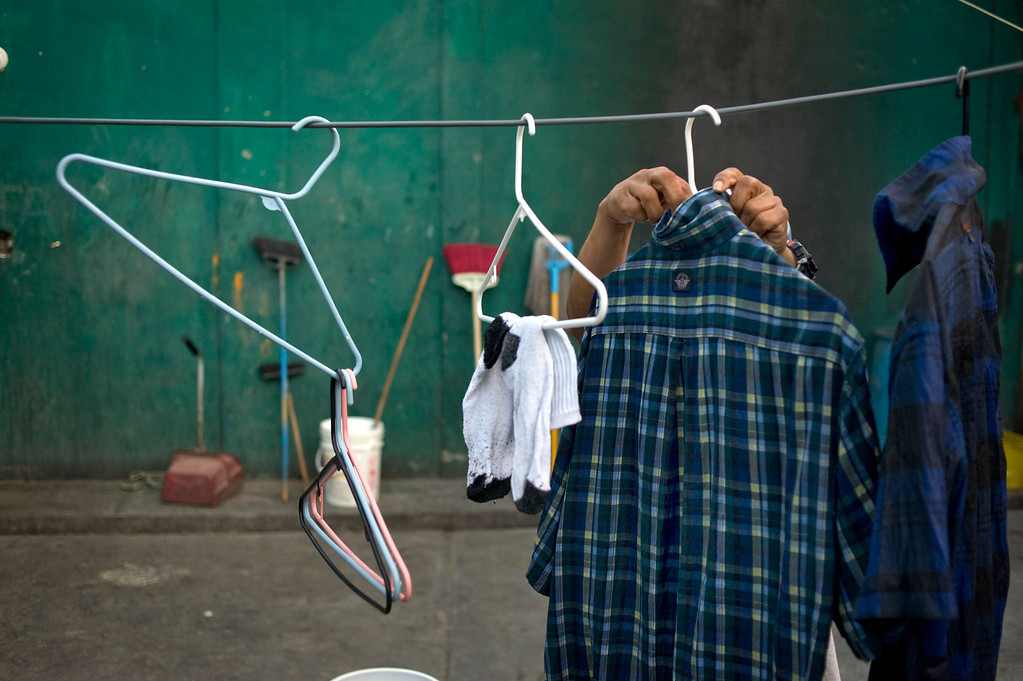 . A homeless man who was deported from the US to Mexico several years ago tends his washed clothes to dry in the patio of the Casa Refugio Elvira homeless shelter in Tijuana, Mexico, 28 April 2013. Heightened US border security and record numbers of deportations from the US have created a growing population of people who live homeless in Mexican cities that border with the United States. Many had lived for years undocumented in the US and have little or no family and other support in Mexico, and are subject to fall into depression, substance abuse and crime. Tijuana, Mexico, borders on the US city of San Diego, California.  EPA/DAVID MAUNG