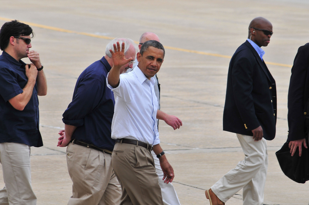 . President Barack Obama waves to a group of armed forces personnel and several families affected by the May 20th tornado at Tinker Air Force Base as he departed from his visit to Moore, Okla. on Sunday May 23, 2013 in Oklahoma City. (AP Photo/Nick Oxford)