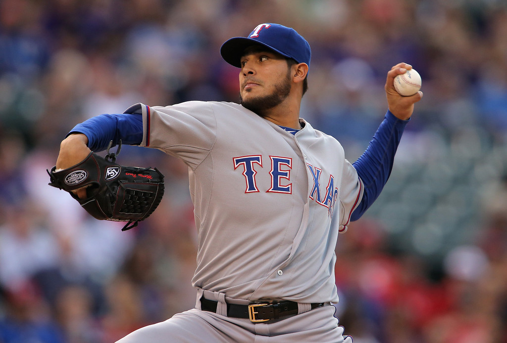. Starting pitcher Martin Perez #33 of the Texas Rangers delivers against the Colorado Rockies during Interleague play at Coors Field on May 5, 2014 in Denver, Colorado.  (Photo by Doug Pensinger/Getty Images)