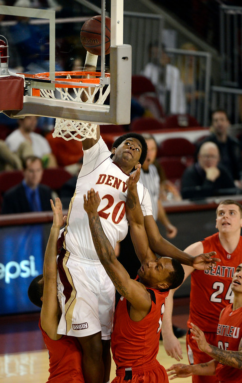 . DENVER, CO. - FEBRUARY 07: Royce O\'Neale (20) of the Denver Pioneers goes up for a dunk on David Trimble (25) of the Seattle Redhawks and Allen Tate (1) during the second half February 7, 2013 at Magness Arena.The Denver Pioneers defeated the Seattle Redhawks 72-55. (Photo By John Leyba/The Denver Post)