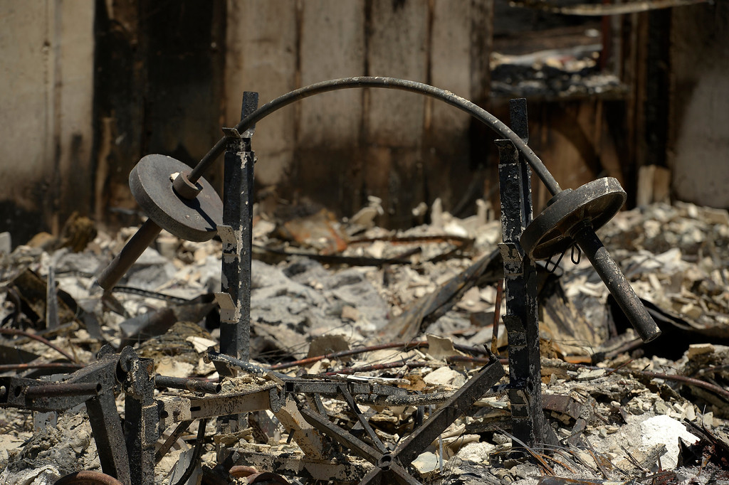 . BLACK FOREST, CO - JUNE 19:  A barbell still sits on the racks inside of what used to be the home of Ray and Cindy Mitchell in Black Forest, CO on June 19, 2013.  Cindy and Ray Mitchell, who live on Darr Drive, came home for the first time since the fire in Black Forest, CO on June 19, 2013.  Her husband Ray had seen the fire coming almost immediately as it had started just southwest of their home. Their\'s was one of the first houses to burn.  The couple had lived in the home for over 22 years and were even married on the property.  The Black Forest Fire stands at 85% containment and more and more homeowners are being allowed back into their homes for a few hours each day. 14, 280 acres have burned and the total number of homes lost increased to 509.  Photo by Helen H. Richardson/The Denver Post)