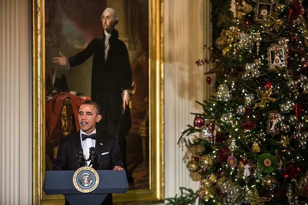 . WASHINGTON - DECEMBER 2: (AFP OUT) President Barack Obama delivers remarks at the Kennedy Center Honors reception at the White House on December 2, 2012 in Washington, DC. The Kennedy Center Honors recognized seven individuals - Buddy Guy, Dustin Hoffman, David Letterman, Natalia Makarova, John Paul Jones, Jimmy Page, and Robert Plant - for their lifetime contributions to American culture through the performing arts. (Photo by Brendan Hoffman/Getty Images)