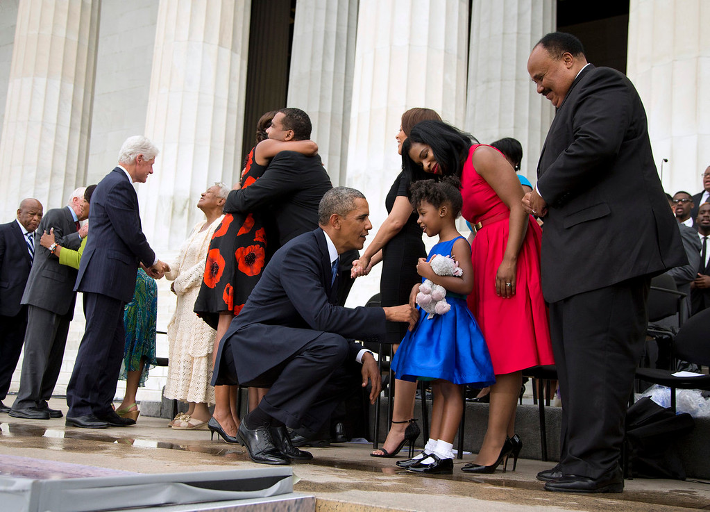 """. President Barack Obama talks with Yolanda Renee King, 5, granddaughter of Martin Luther King Jr., her mother Arndrea Waters, and Martin Luther King III, right, after speaking at a ceremony commemorating the 50th anniversary of the March on Washington, Wednesday, Aug. 28, 2013, at the Lincoln Memorial in Washington. The president was set to lead civil rights pioneers Wednesday in a ceremony for the 50th anniversary of the March on Washington, where Dr. Martin Luther King\'s \""""I Have a Dream\"""" speech roused the 250,000 people who rallied there decades ago for racial equality. From left are, Rep. John Lewis, D-Ga., former President Jimmy Carter and former President Bill Clinton.  (AP Photo/Evan Vucci)"""
