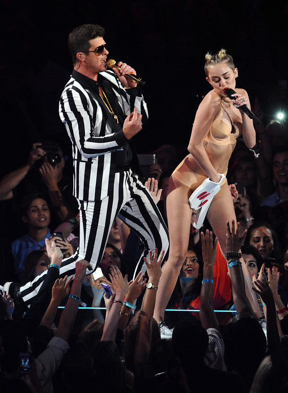 ". Robin Thicke, left, and Miley Cyrus perform ""Blurred Lines\"" at the MTV Video Music Awards on Sunday, Aug. 25, 2013, at the Barclays Center in the Brooklyn borough of New York. (Photo by Charles Sykes/Invision/AP)"