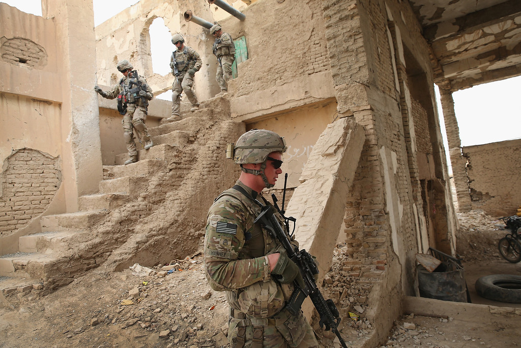 . SSG Trevor Harney (front), from Continental, Ohio and other soldiers from the U.S. Army\'s 4th squadron 2d Cavalry Regiment visit an Afghan National Police (ANP) outpost that was once home to Osama Bin Laden on February 25, 2014 near Kandahar, Afghanistan.   (Photo by Scott Olson/Getty Images)